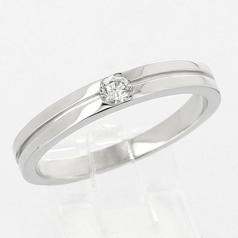 Solitaire double anneaux or et diamant 0,10 ct. Serti massé