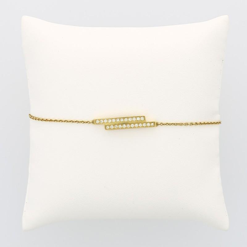 Bracelet femme double barrettes décalées serti de 24 diamants en grains pour un caratage total de 0,24 carat en or 18 carats