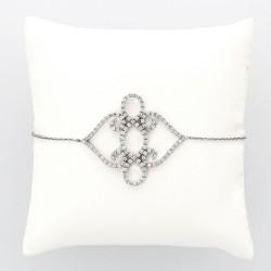 Bracelet motif volute pavé serti mini griffes diamants 1,06 carat-or 18 carats