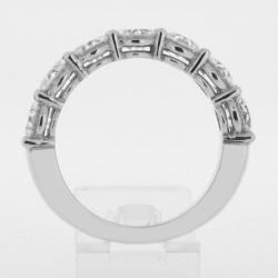Alliance pour femme diamants sertis sur griffes en or 18 carats